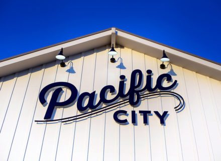 Pacific City Environmental Graphics Identity Signage Wall Mount Fascia Sign