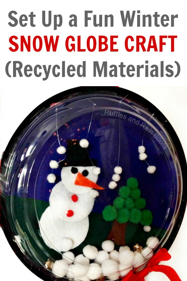 Make this fun, quick, and easy snow globe craft for kids. It's a great winter craft for preschoolers and uses recycled materials. #snowglobe #wintercrafts #wintercraftsforkids #snowman #snowmancrafts #holidaycrafts #snowglobeforkids #pompoms #feltcrafts #recycledcrafts #DIYrecycle #rufflesandrainboots