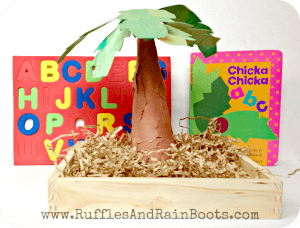 photo of learning prompt set up for Chicka Chicka ABC book for kdis