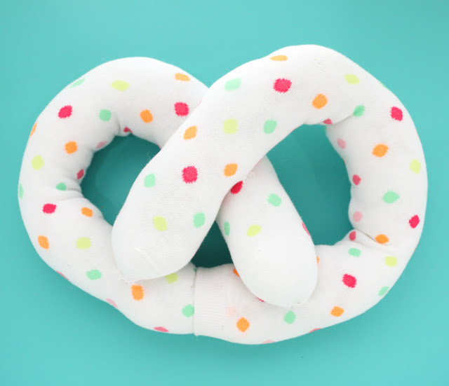 DIY sock toys and fun gifts for any occasion - pretzel pillow made from socks