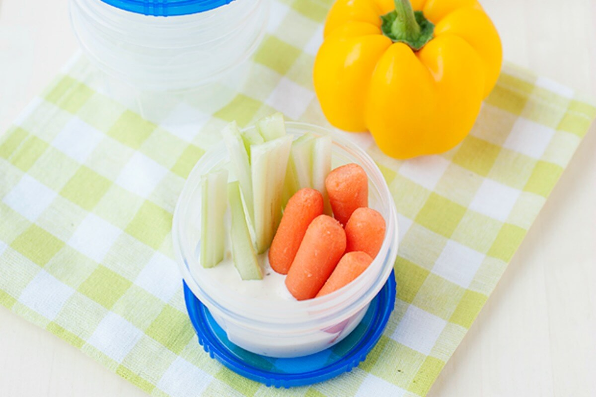 Veggies in cup for road trip snacks for kids
