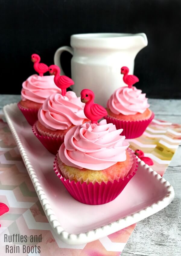 These amazing and fun homemade flamingo cupcakes feature swirl batter and fun icing decorations. #flamingo #luau #partyideas #summerfun #summerpartyideas #rufflesandrainboots