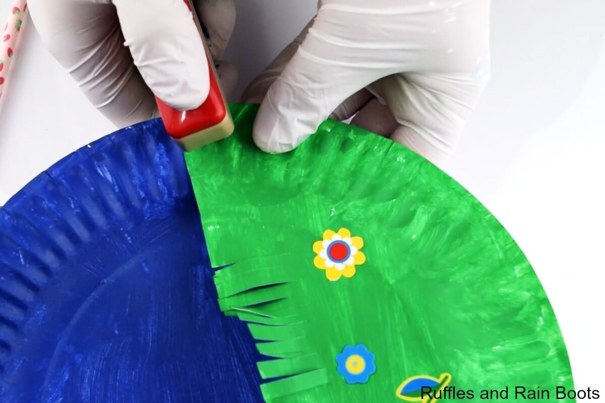 staple two paper plates together and make a peek a boo puppet for kids