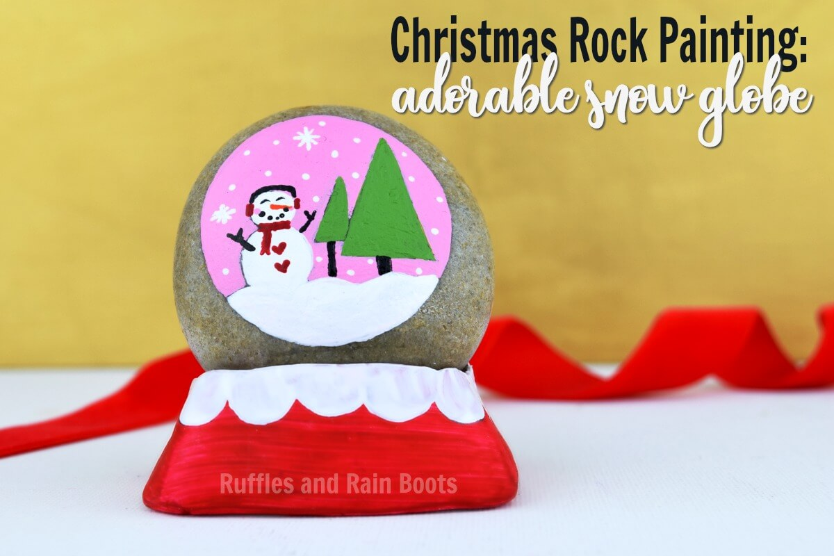 snow globe rock painting with polymer clay stand