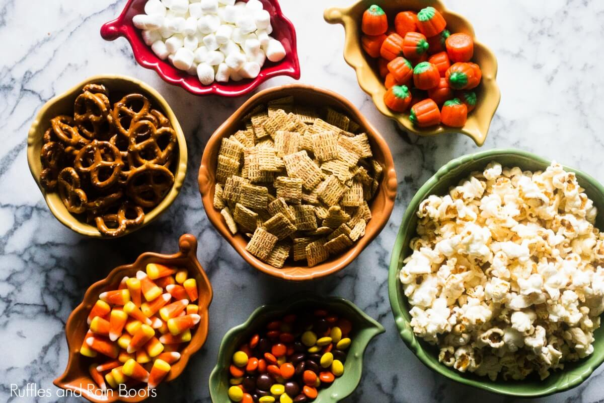 popcorn snack mix ingredients on a marble table
