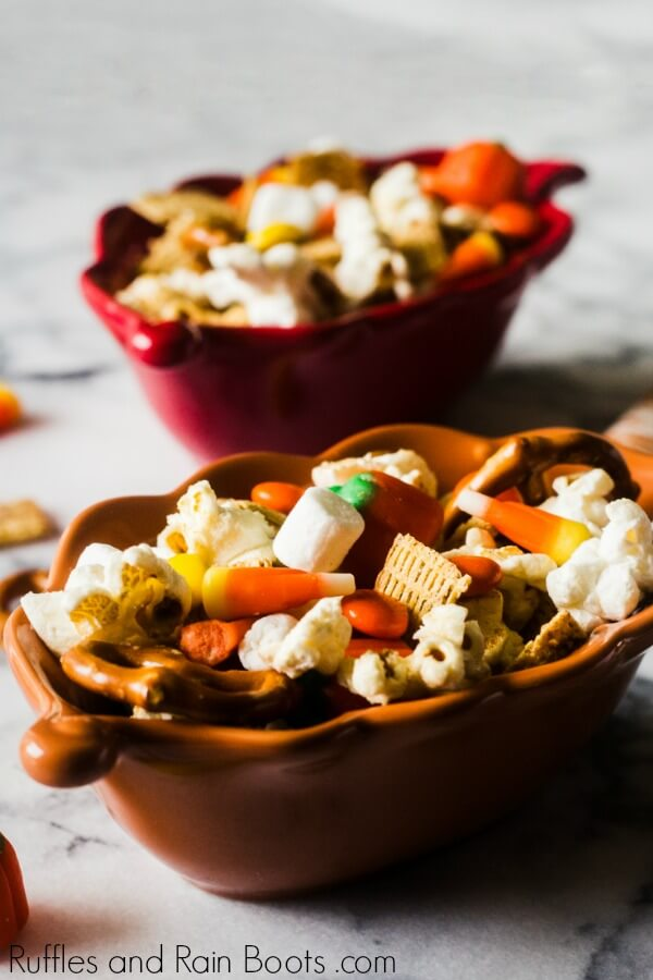 fall snack mix with popcorn cinnamon cereal pretzels marshmallows candy corn and candy