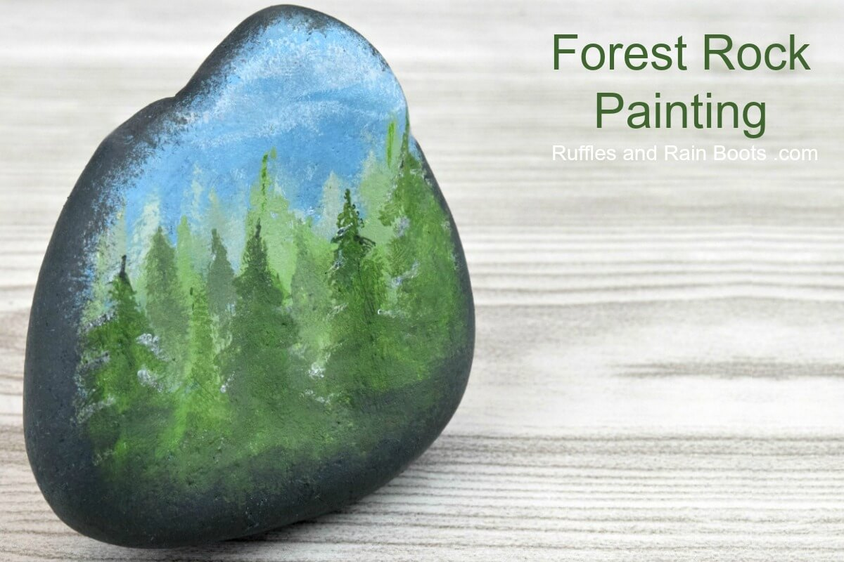 a painted rock with a Fall Rock Painting Forest in One Color