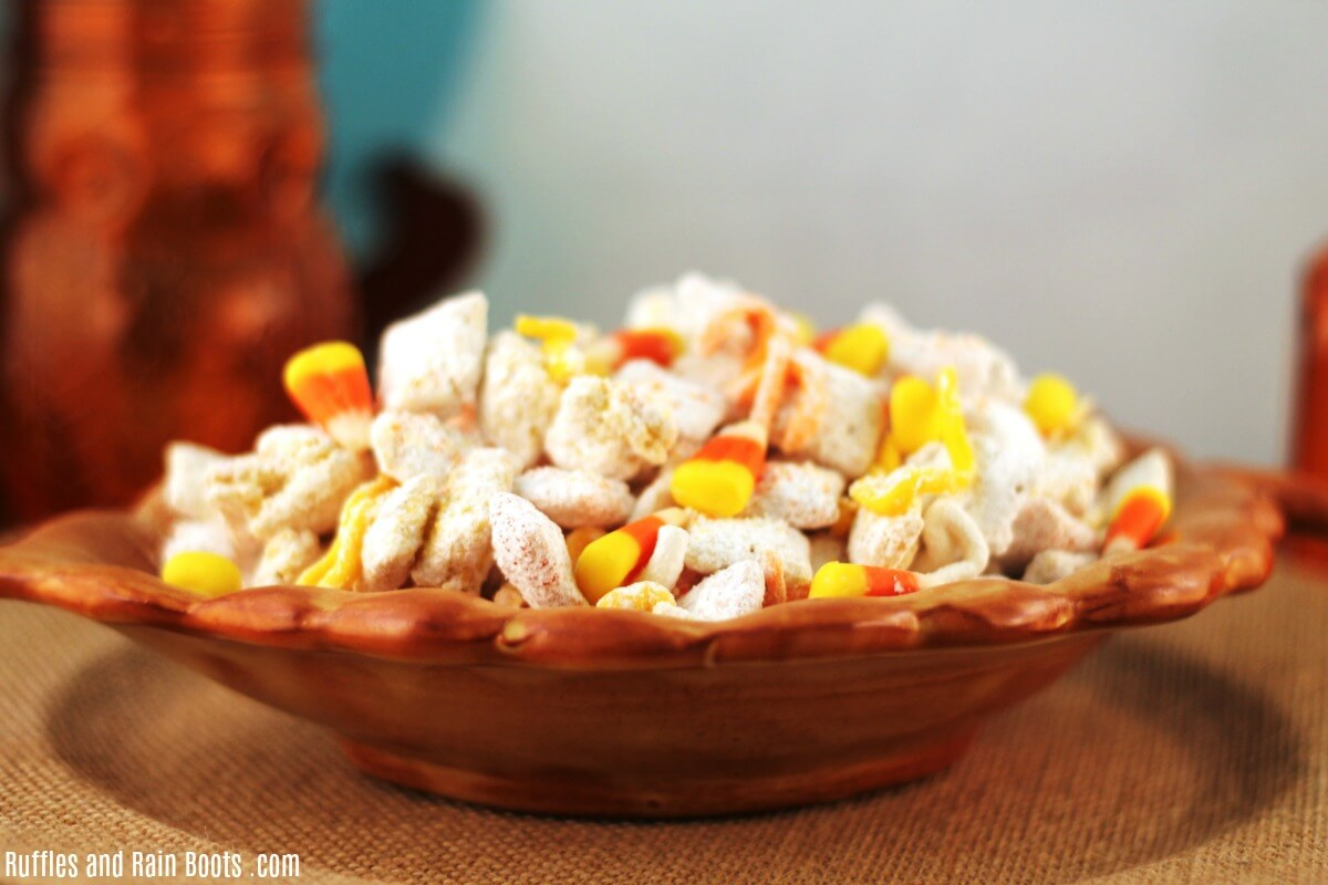 in an acorn bowl is Candy Corn Puppy Chow Recipe Muddy Buddy Chex Mix