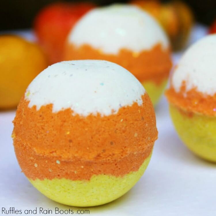 candy corn bath bombs on white table