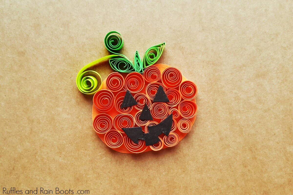 quilled pumpkin on kraft paper background