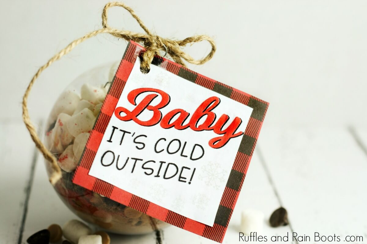 salted caramel hot chocolate mix in ornament with gift tag which reads Baby, It's Cold Outside
