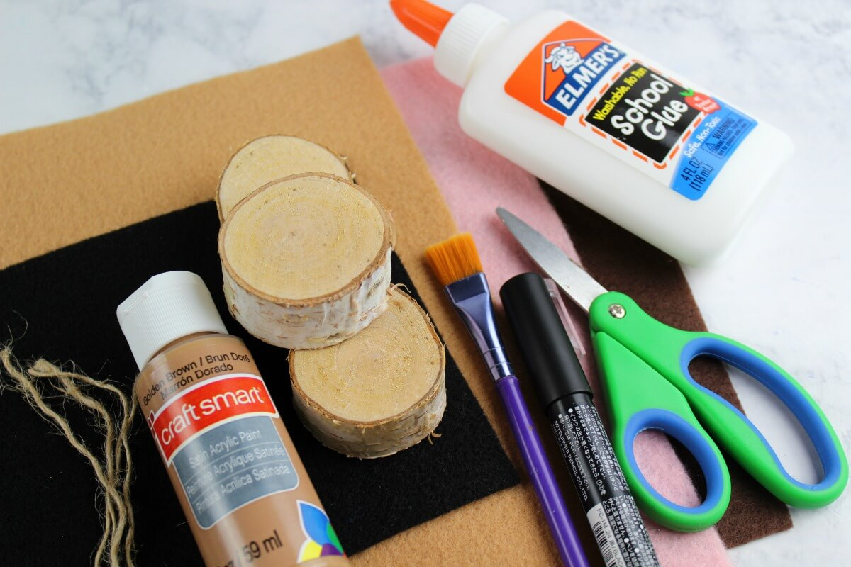 Supplies needed for a fun easy DIY Christmas ornament idea with wood rounds