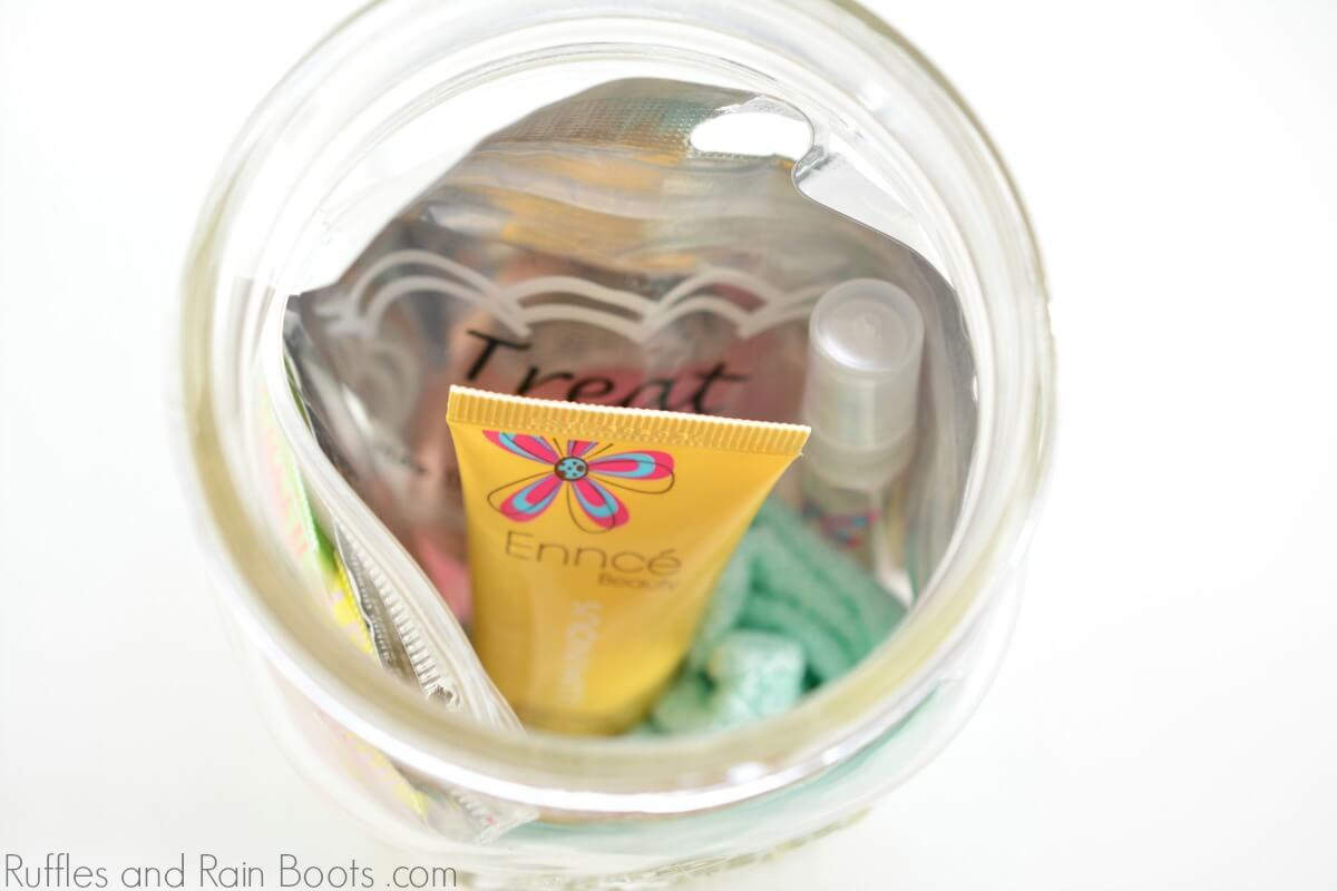 close up of filled mason jar gift for teens with pampering mini gifts