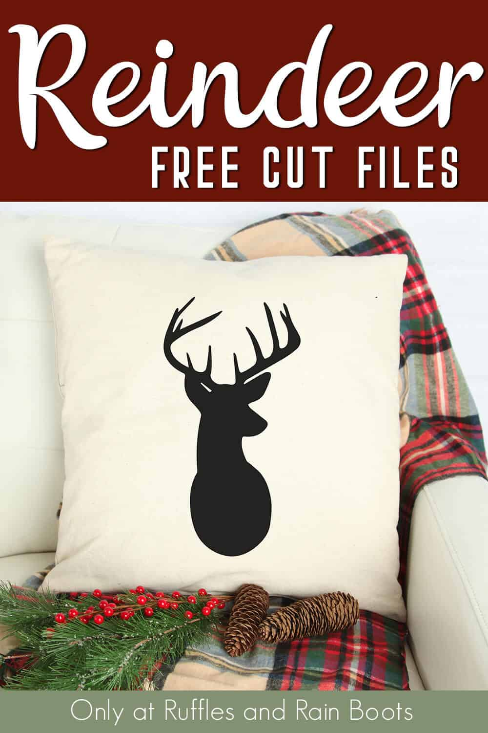 pillow with deer silhouette on a pillow sitting on a couch with text which reads reindeer free cut files