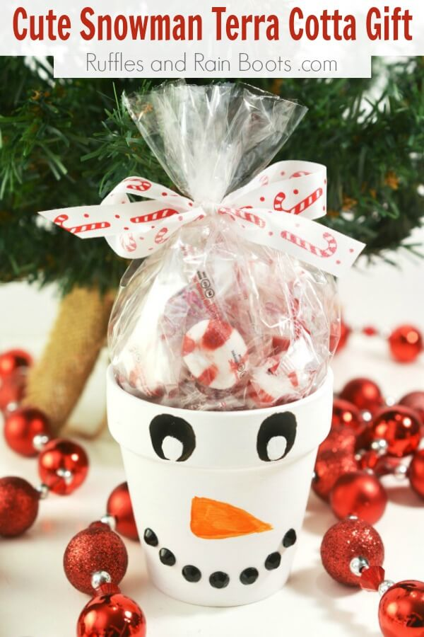snowman painted clay pot with text which reads cute snowman terra cotta gift