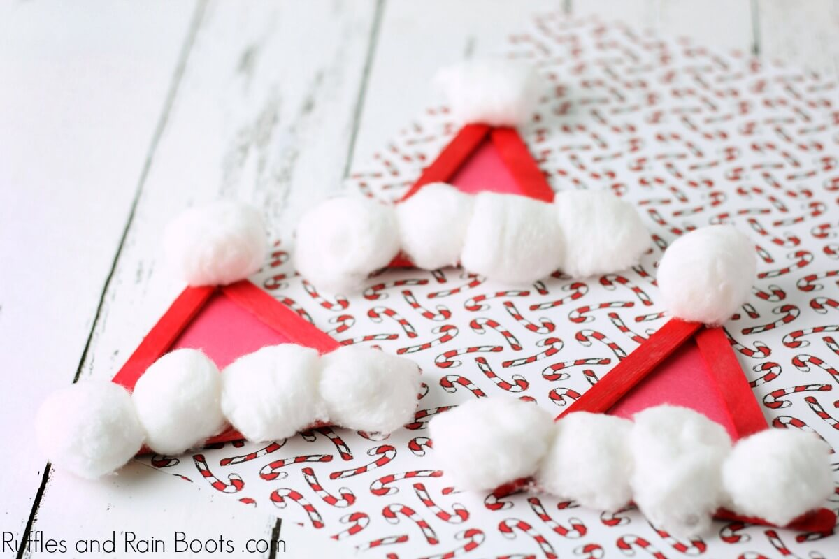 Santa Hat Craft Stick Ornament on holiday paper
