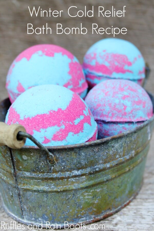 pink and blue bath bombs with decongestant recipe with text which reads winter cold relief bath bombs recipe