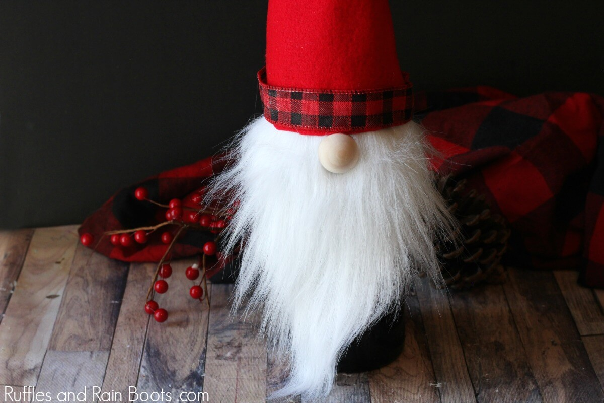 Christmas gnome wine bottle cover on holiday background