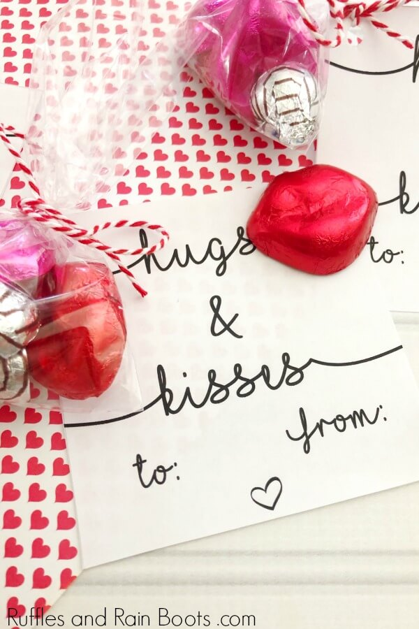 close up of hand lettered hugs and kisses Valentine card