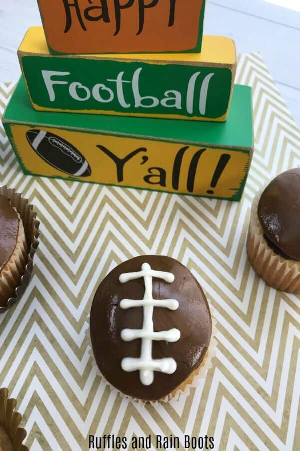 game day dessert of football shaped cupcake on football background