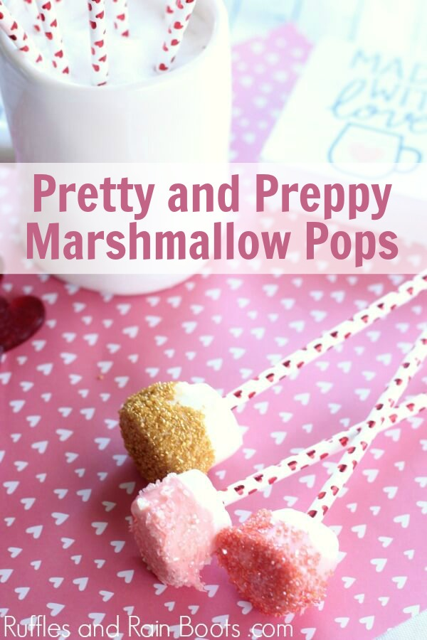 valentines day dipped marshmallows on pink heart background with text which reads pretty and preppy marshmallow pops