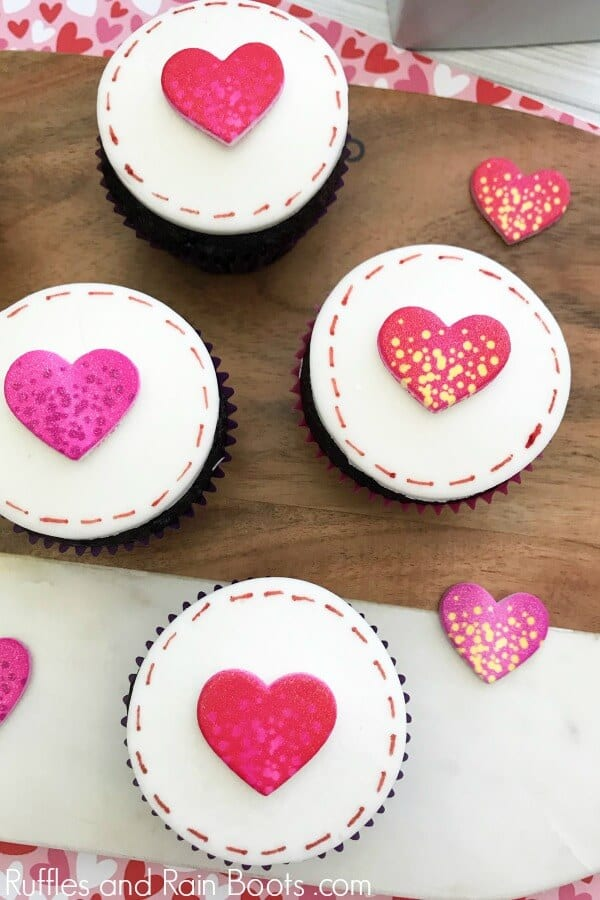 These love letter cupcakes are easy to put together and are perfect for a large crowd or party. Click to see how she makes it so easy! #valentinesday #cupcakes #cupcakerecipes #rufflesandrainboots