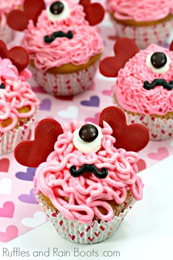Adorable love monster cupcakes are so much fun to make and eat! Click to see how quickly this Valentine's Day cupcake comes together. #valentinesday #cupcakes #monsters #rufflesandrainboots