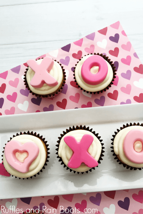 These adorable and easy hugs and kisses cupcakes for Valentine's Day are perfect for the sweetest holiday. Click to see how she uses a secret ingredient to make them easy. #valentinesday #cupcakerecipes #rufflesandrainboots