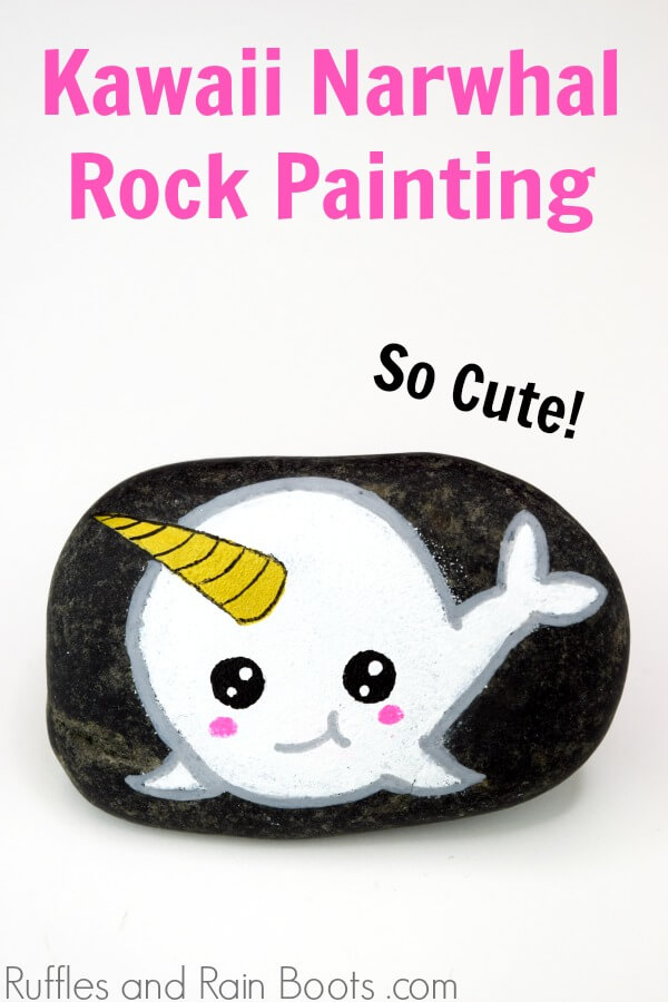 Narwhal Rock Painting Idea on black rock on white background with text which reads Kawaii Narwhal rock painting
