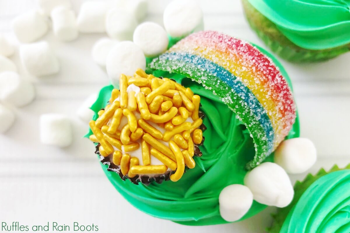 Pot of Gold Cupcakes for St Patricks day on wood background