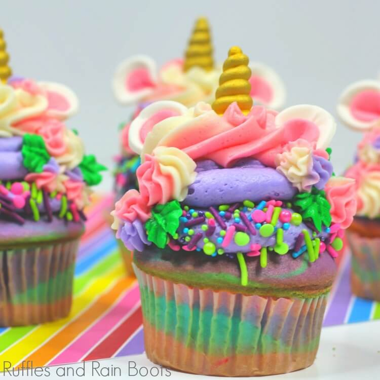 unicorn cupcake on rainbow paper