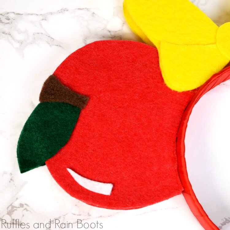 close up of Snow White apple from felt for DIY Mickey ears