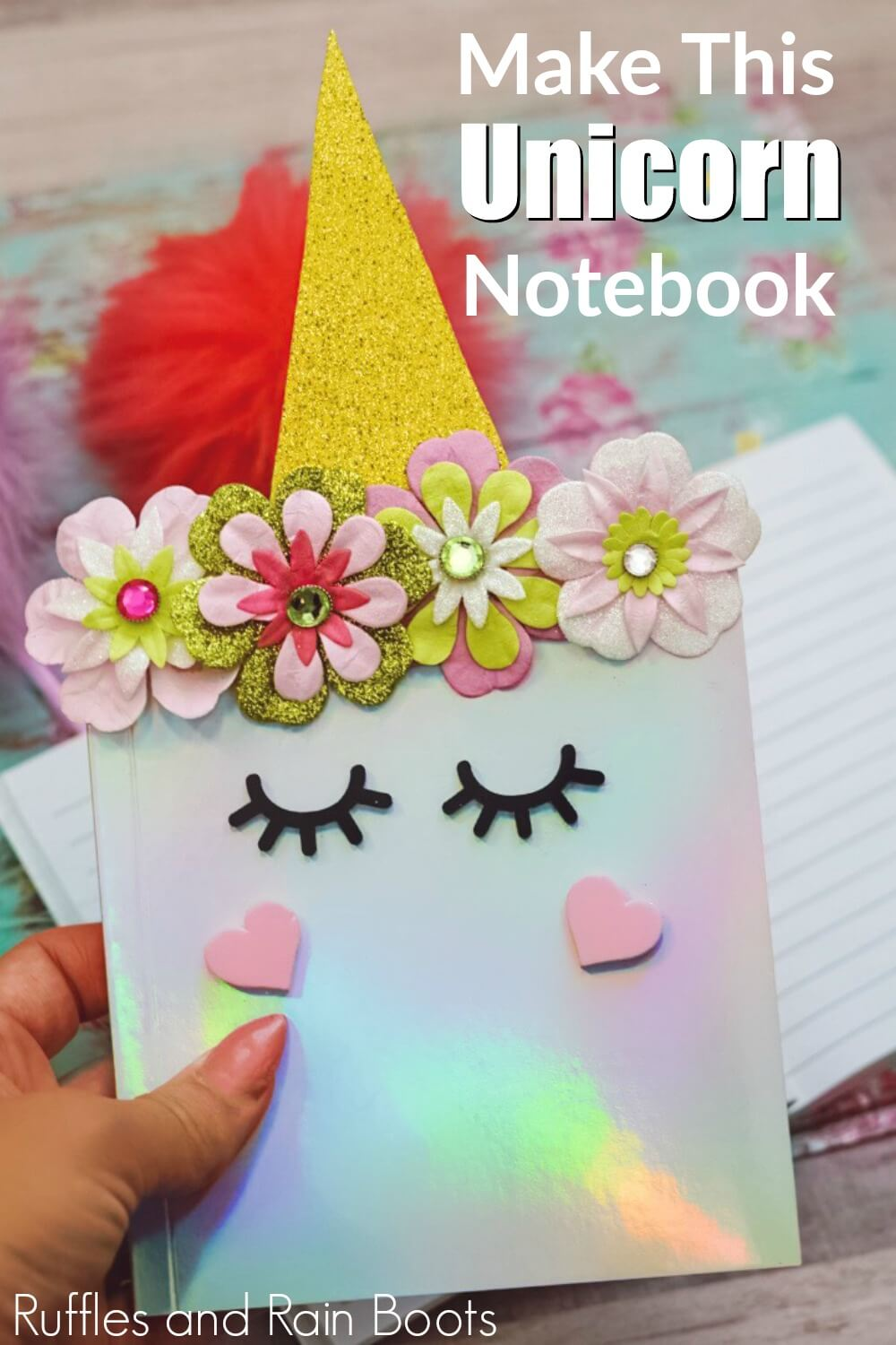 hand holding DIY unicorn notebook for closer image with text Make this Unicorn notebook