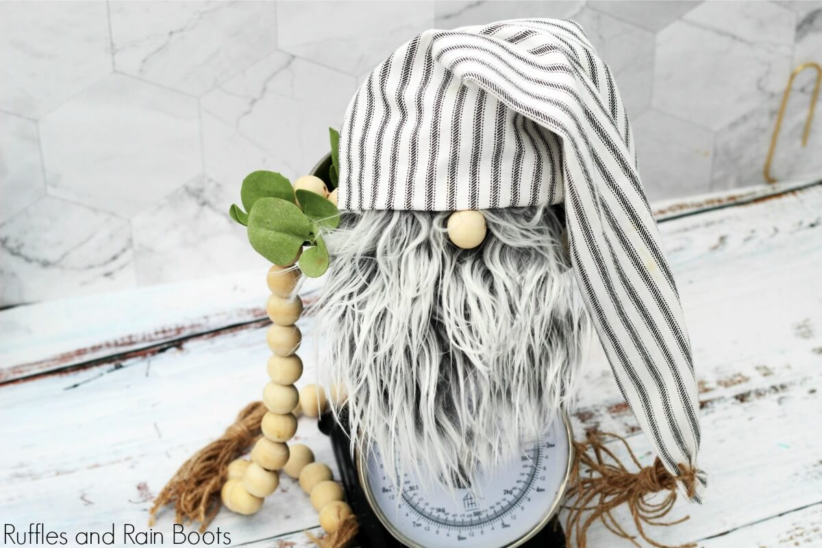 close up of farmhouse gnome on kitchen scale on white background