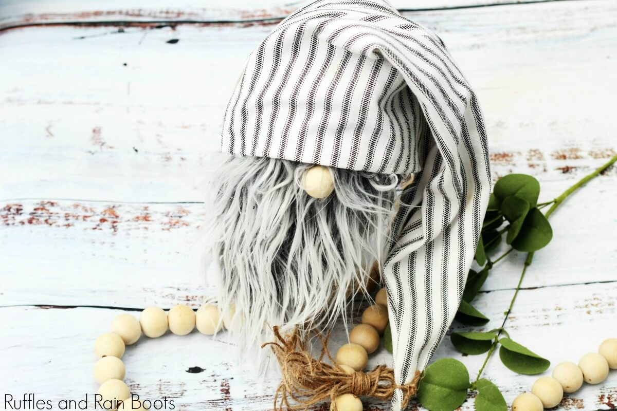 DIY farmhouse gnome on white background with natural and rustic elements