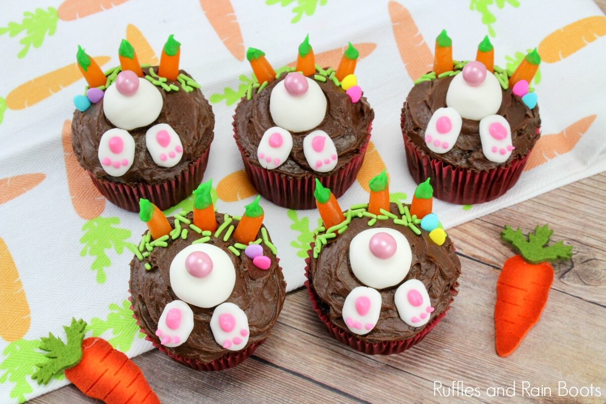 picture of 5 bunny cupcakes for Easter on carrot cloth and Eater paper background