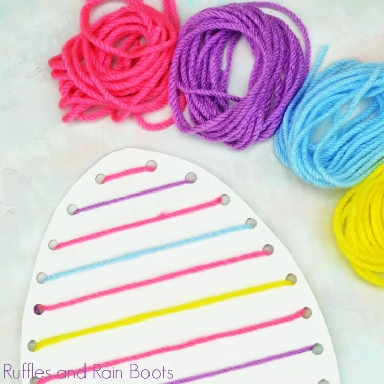 close up Easter egg lacing craft and different colors of string used