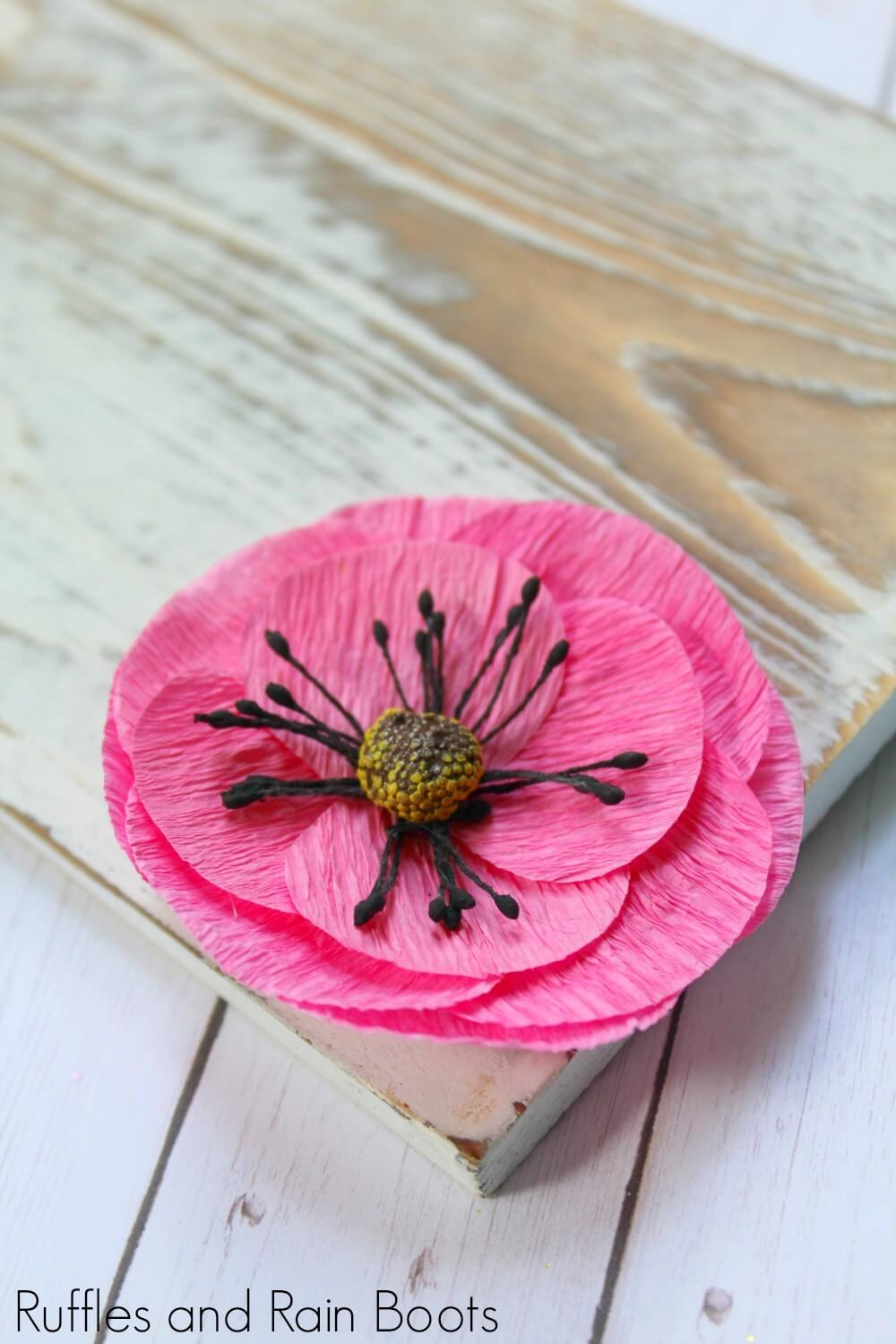 close-up of pink flower decoration for a farmhouse sign for spring for a spring farmhouse