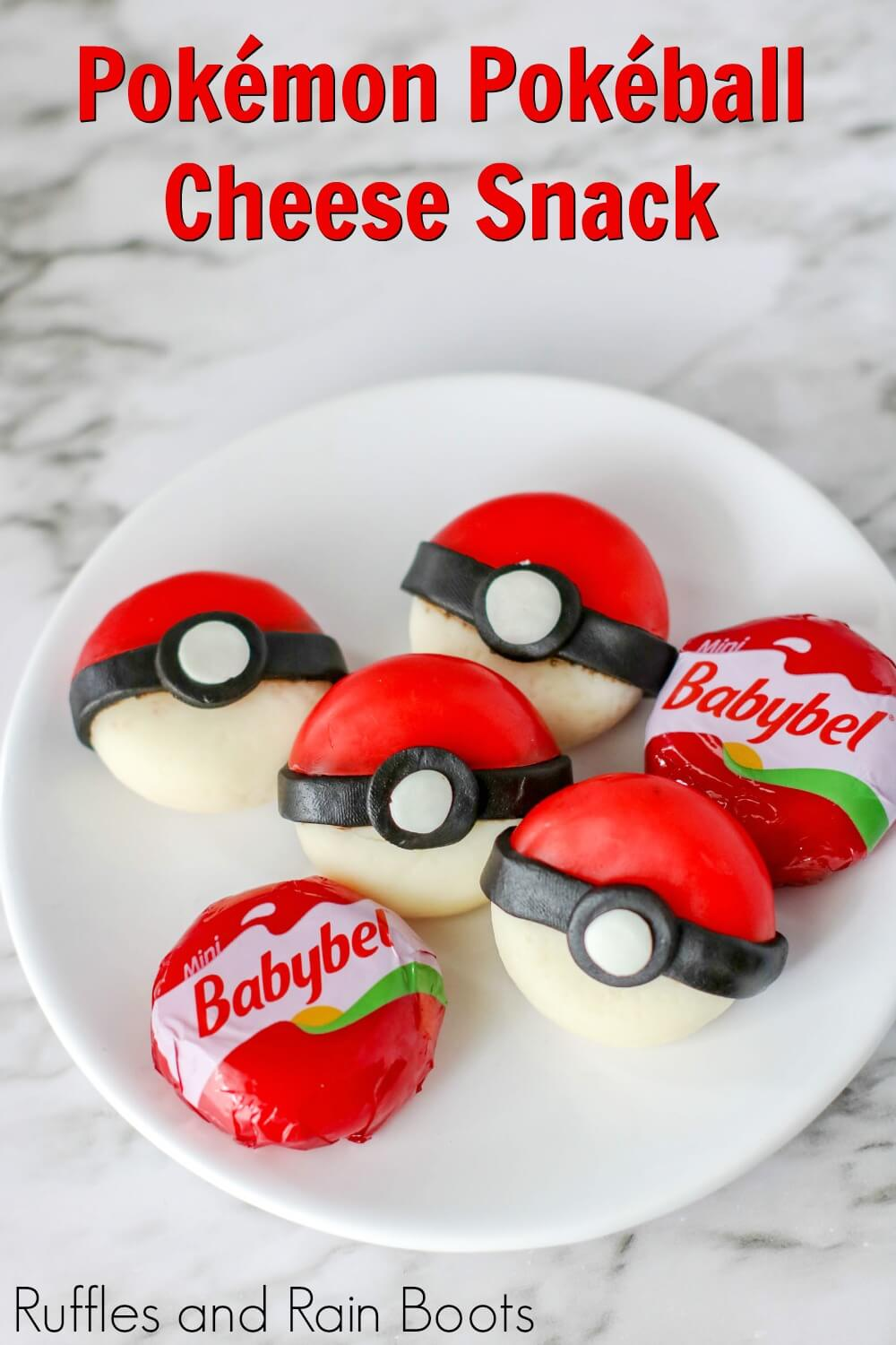 pokeball cheese snack on a plate with text which reads pokemon pokeball cheese snack