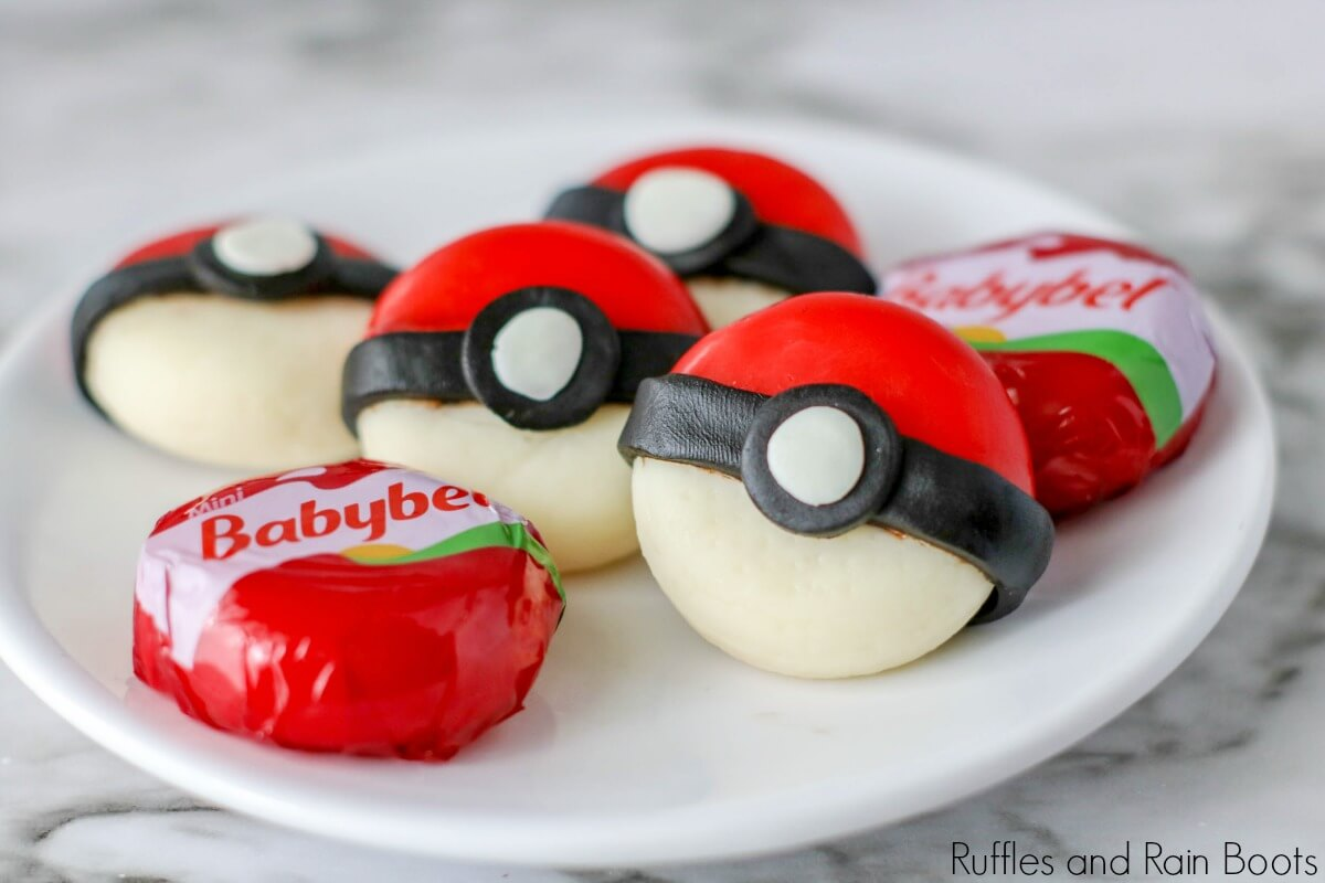 cheese shaped like pokeball cheese snack on a white plate
