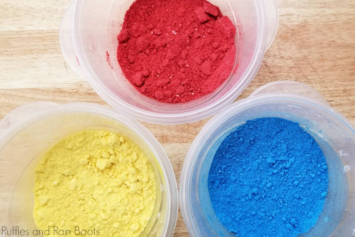 in-process step of red, yellow and blue pigmented bath bomb mix to be made into snow white bath bombs