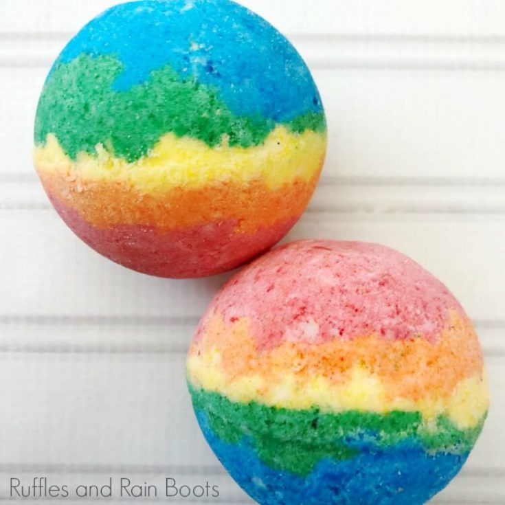 two rainbow bath bombs on a white background