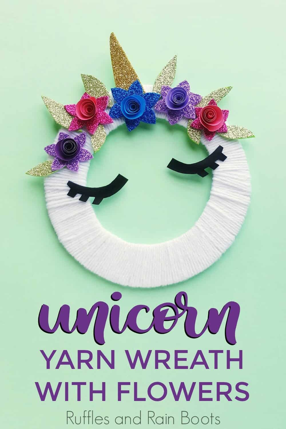 unicorn wreath unicorn craft for kids on a teal background with text which reads unicorn yarn wreath with flowers