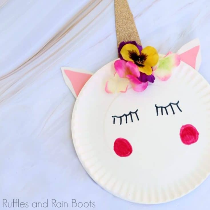 close up of unicorn paper plate craft on white marble table