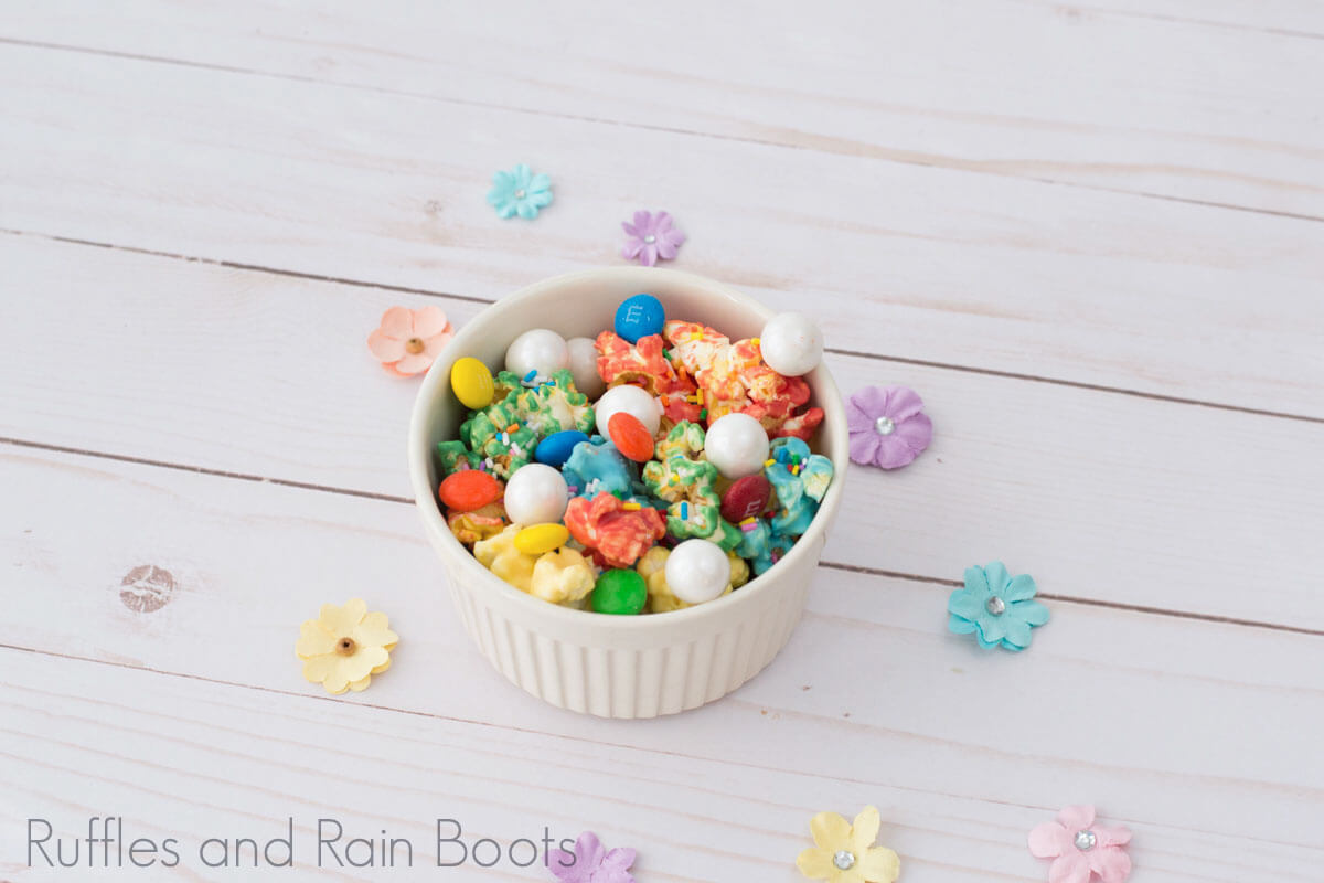 rainbow popcorn on white wood background