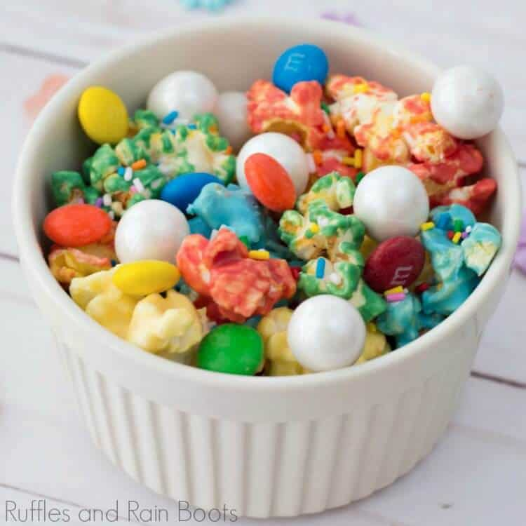 rainbow popcorn recipe in a white bowl on a white background