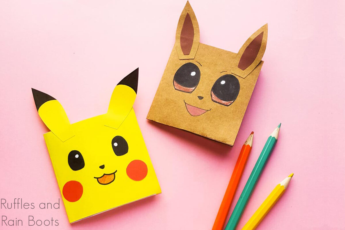 diy pokemon notebooks project for kids on a pink backgrond with pencils