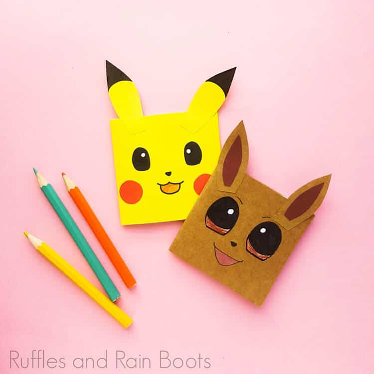 diy pokemon notebooks on a pink background with pencils
