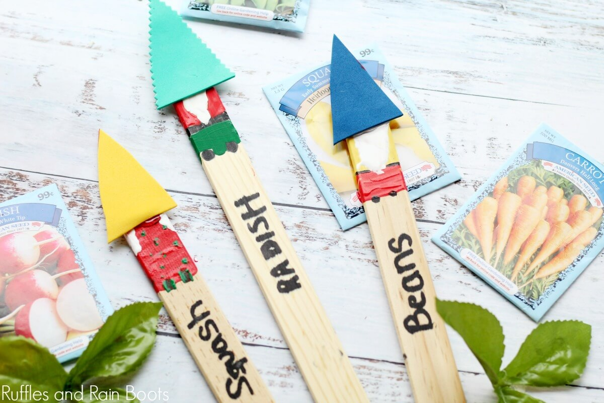 garden gnome plant markers close up on white table with seed packets