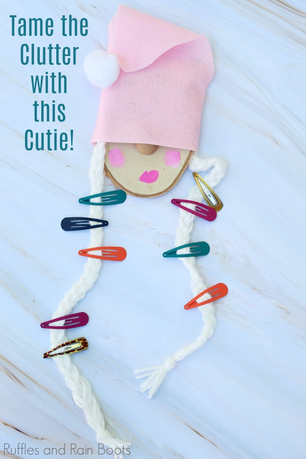 close up of gnome barrette holder with text Tame the clutter with this cutie!